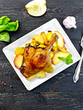 Duck leg with apple and potatoes in plate on board top - 161148403