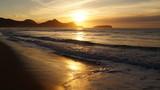 Sunrise over Beach and Sea