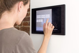 Woman using tablet in wall Smart House - 161169068