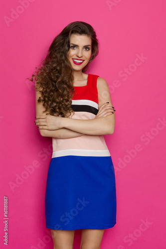 Beautiful Vibrant Young Woman Posing With Arms Crossed
