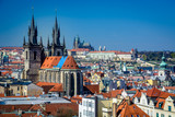 Overview of Prague rooftops, Church of our Lady before Tyn and Prague Castle on a sunny day