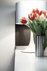 Bouquet of tulips in steel vase, interior