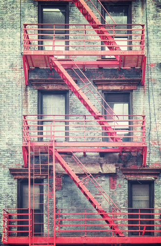 Retro stylized photo of a residential building fire escape in Manhattan, New York City, USA. - 161211400