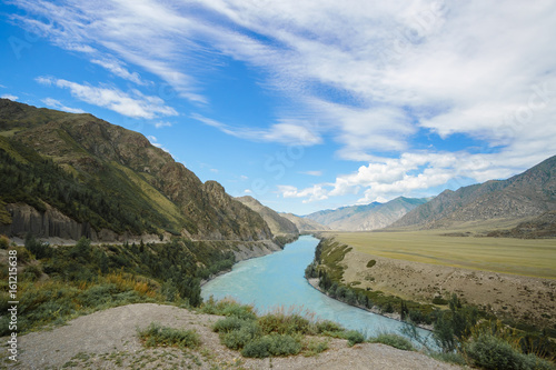 Photo of the scenery of the mountainous area and the river.