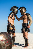 Spartan warrior holding a Roman for his helmet - 161216838