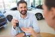 Agent Giving Car Key To Woman