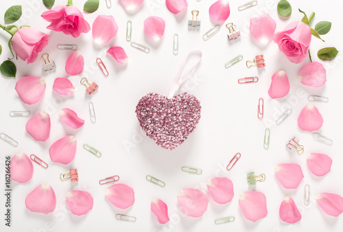 Valentines Day theme with rose petals and heart shaped decorations
