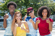 Quadro Multi ethnic group of latin and african american and caucasian young adults showing thumb