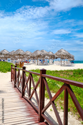 Wooden walkway leading to the shore at the beautiful Varadero beach in Cuba
