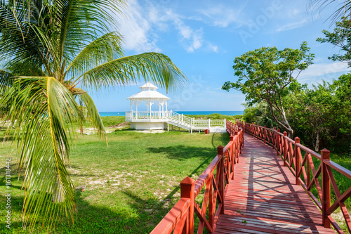 Fototapeta Wooden walkway leading to the shore at Varadero beach in Cuba