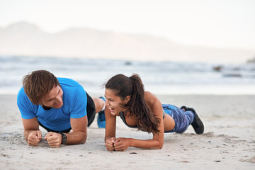 Attractive Couple having fun Doing Planking Exercise