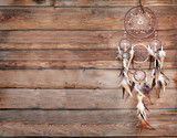Dreamcatcher, american native amulet on wooden background. Shaman - 161330256