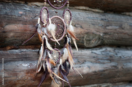 Dreamcatcher, american native amulet on wooden background Poster