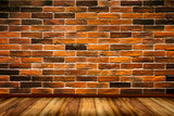 Red bricks wall with wood floor texture background.