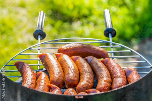 Barbecue grill with sausage grilling, weekend party outdoors © alicja neumiler
