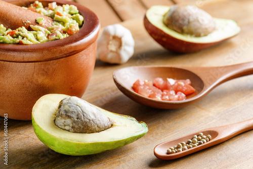 Closeup view of avocado and fresh homemade Guacamole