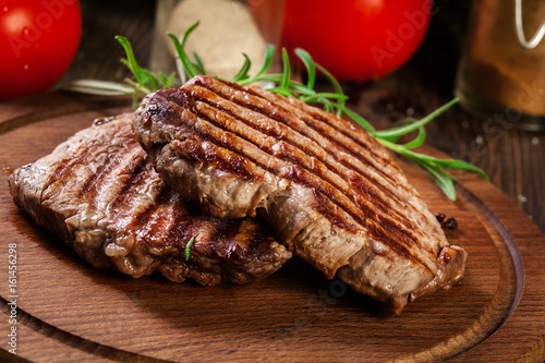 Succulent portions of grilled fillet mignon served with rosemary - 161456298