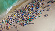 Quadro People on Ipanema Beach in Rio de Janeiro, Brazil. Top view with ocean and colorful umbrellas