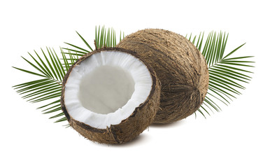 Whole and half coconut with leaves isolated on white background