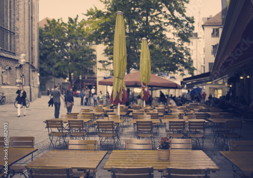 Open air restaurant on the city street in the center of the town. Munich. Retro effect...