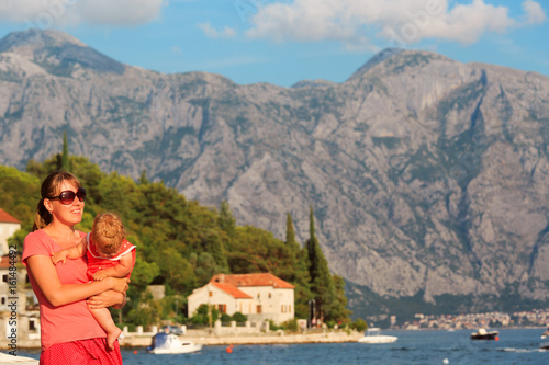 Poster mother with little daughter on vacation in Montenegro