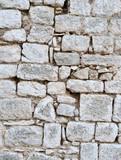 The old limestone brick wall.