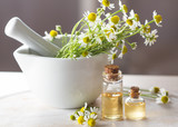 Camomile essential oil and camomile flowers