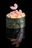 Gunkan maki sushi with shrimps on black background with reflection