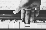 male musician hands playing on piano keys, black and white - 161599233