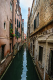 Panoramic view on famous Grand Canal among historic houses in Venice, Italy