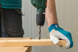 Carpenter handyman using electric drill