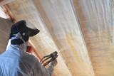 Polyurea Spraying, warming foam coating of roof, focus on wall - 161668807
