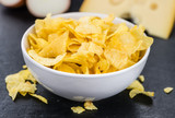 Rustic slate slab with Potato Chips (Cheese and Onoion taste) (selective focus)