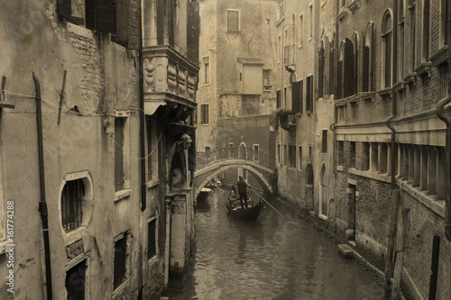 Vintage view of Venice with gondola. Effect with grunge background