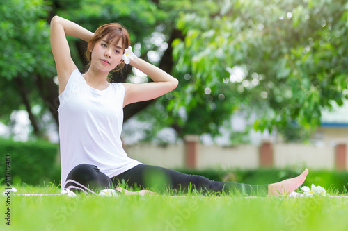 Closeup of women doing yoga in park
