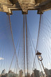 Brooklyn Bridge: symmetrical view of overhead steel cables w/ lamp post in lower-right