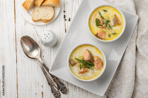 Fototapeta Creamy fish soup with salmon, potatoes, onions and carrots. Kalakeitto. Traditional dish of the Finnish cuisine