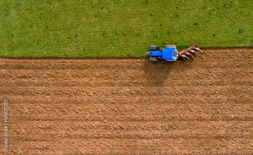 Aluminium Trekker Tractor Ploughing Plowing Field - Aerial Shot
