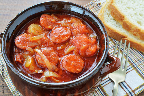 Lecho vegetable stew  in ceramic pot with bread