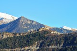 A small mountain village in front of french Alps from the Ecrins Massive. Massif des Ecrins