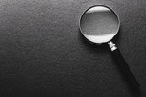 magnifying glass on  black texture  background. - 161861076