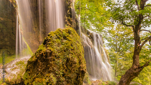 The waterfall to the Holy Trinity monastery in Etropole is also called Varovitetz, where the famous Etropole calligraphy-art school of literature arises. Etropole. Bulgaria - 161862274