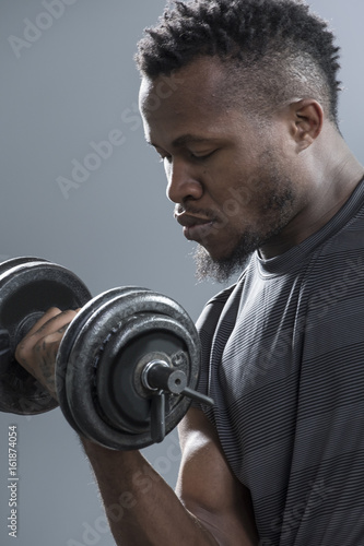 Close up of man's biceps during doing curling exercise