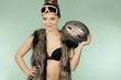 Quadro Woman wearing bra and holding ski helmet