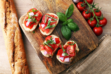 Bruschetta with tomatoes, herbs and oil on toasted garlic cheese bread toasted with chopped tomatoe