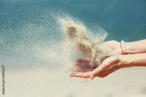 Female hands releasing dropping sand Poster