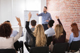 Group Of Businesspeople Raising Hands In Conference - 161923883