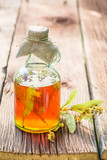 Healthy tincture in bottles as homemade cure in summer - 161934027