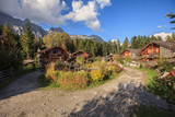 Idyllic chalets in the Alps, in the midst of alpine mountain landscape