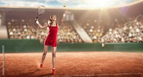 female tennis player on a tennis court ready to hit a tennis ball